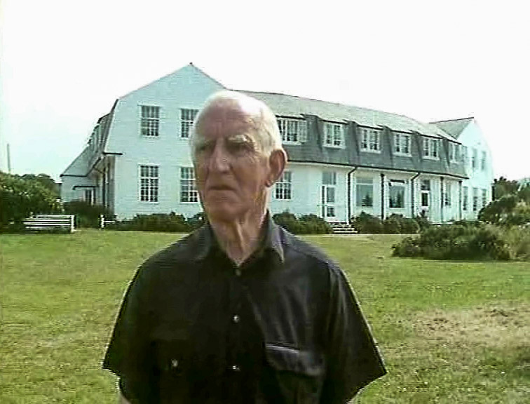 Ray Davey, Founder of the Corrymeela Community, outside the old Corrymeela House, Ballycastle. (1989)
