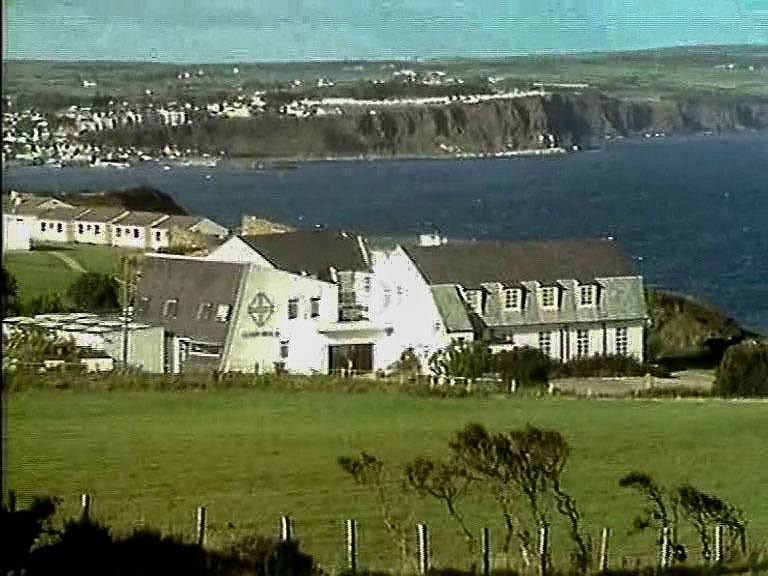 The old Corrymeela complex as it was in the 1980's, with Ballycastle village in the background.